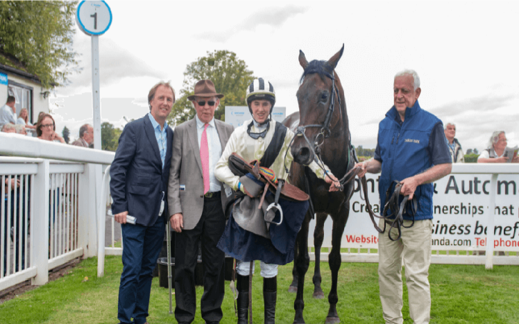 An image of a race winning team at Worcester Racecourse