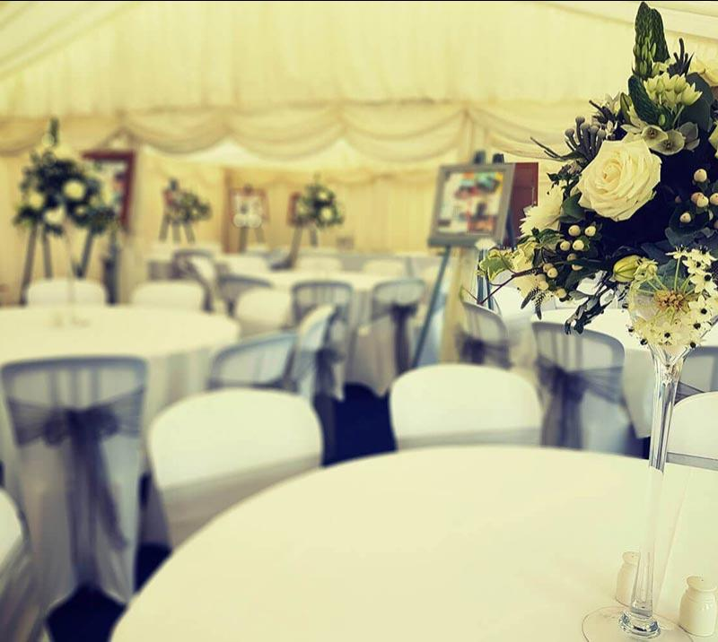 The interior of the Parade Ring Marquee at Worcester Racecourse decorated in a wedding theme.
