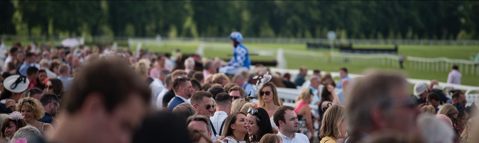 Crowds at the races at Worcester Racecourse.